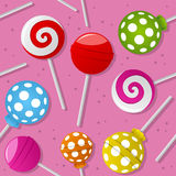 Sweet Lollipop Seamless Pattern. A seamless pattern with colorful sweet lollipop on pink background. Useful also as design element for texture, pattern or gift Royalty Free Stock Photo