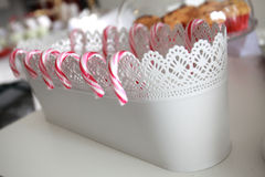 Sweet lollipops in white elegant pot. Candies lollipos with white pot. Stock Image