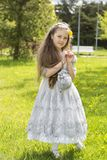 Sweet long-haired princess looks absolutely adorable Stock Photos