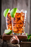 Sweet Long Island drink with cola and citrus fruits Royalty Free Stock Photo
