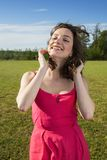Sweet looking female enjoys warm sunny weather Royalty Free Stock Images