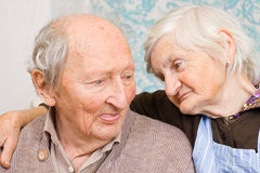 Sweet love. Old happy grandparents staying together on the bed Royalty Free Stock Images