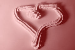 Sweet love. I took some cream and madeit look like a heart on a white paper.Then changed the colours to pink..sweet love and tempting to eat too Royalty Free Stock Photography