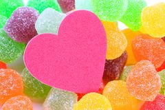 Sweet love. Colourful soft jelly candy with heart shape object isolated on white background. Concept for sweet love stock photography