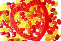 Sweet Love. Jelly sweets/candy back lit with a heart shape to the front stock photo