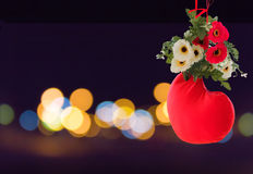 Sweet lovely background of red heart decorated with flower on bokeh light at night Royalty Free Stock Photography