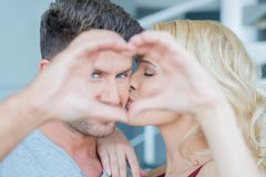 Sweet Lovers in Hard Heart Sign Royalty Free Stock Images
