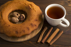 Sweet lush cupcake with tea. In white dish on wooden table Stock Image