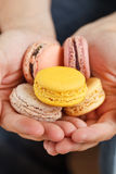Sweet macarons. On the hands royalty free stock photography