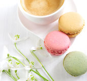 Sweet macarons with coffee Stock Images