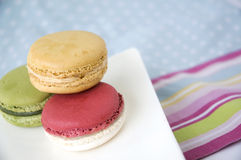 Sweet macarons on colorful background Stock Images