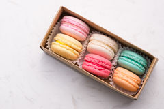 Sweet macarons. Different french cookies macaroons in a paper bo Stock Image