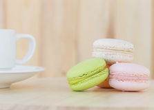 Sweet Macaroons , macarons with cup on wooden background. Sweet Macarons , Macaroons with cup on wooden background stock image