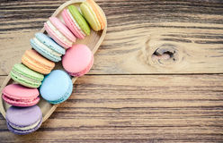 Sweet macaroons on wooden background. Top view Stock Photo