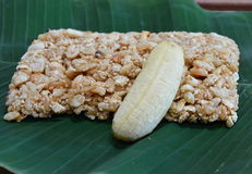 Sweet made of rice nut sesame eat with golden banana for Thai merit day Stock Image