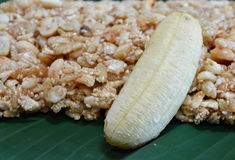 Sweet made of rice nut sesame eat with golden banana for Thai merit day Stock Photography