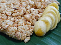 Sweet made of rice nut sesame eat with golden banana for Thai merit day Royalty Free Stock Image