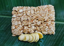 Sweet made of rice nut sesame eat with golden banana for Thai merit day Stock Photos