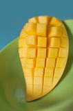 Sweet Mango slice on green plate Royalty Free Stock Images