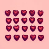 Sweet many red decorative hearts on a pink Royalty Free Stock Photography