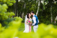 Sweet marriage couple in love going to kiss. In the green nature countryside background Royalty Free Stock Photos