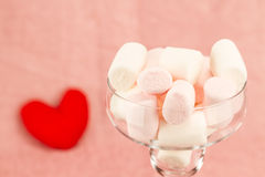 Sweet marshmallow and heart on a pink background Stock Photography