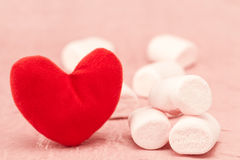 Sweet marshmallow and red heart Royalty Free Stock Image