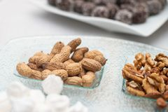 Sweet marshmallow, walnuts and nuts royalty free stock photo