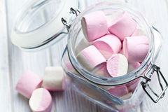 Sweet marshmallows in glass jar Stock Images