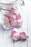 Sweet marshmallows in glass jar Stock Image