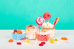 Sweet marshmallows with lollipop. Sweet marshmallows set with lollipop on pastel background with different candies Royalty Free Stock Photos