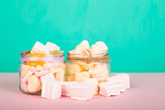 Sweet marshmallows with lollipop. Sweet marshmallows set with lollipop on pastel background with different candies Stock Images
