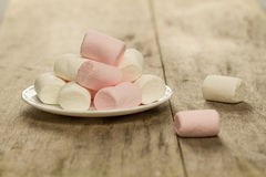 Sweet marshmallows on white plate Royalty Free Stock Images
