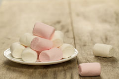 Sweet marshmallows on white plate Stock Photography