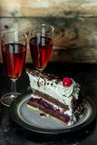 Sweet meal for two: red wine and chocolate cake with cherry and whipped cream royalty free stock image