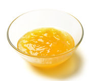 Sweet melon jam in the transparent glass bowl with honey Royalty Free Stock Photos
