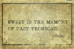 Past troubles Cicero. Sweet is the memory of past troubles - ancient Roman philosopher Cicero quote printed on grunge vintage cardboard Stock Photo