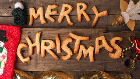 Sweet Merry Christmas cookies on a wooden background Royalty Free Stock Photos
