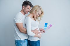 Sweet Middle Age Couple Feels Baby at Womb Royalty Free Stock Photo