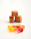 Sweet milk caramels and gummi bonbons. Childhood concept Royalty Free Stock Image