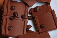Sweet milk chocolate and coffee beans Stock Photos