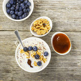 Sweet milk porridge quinoa with honey and walnuts. Top view royalty free stock image