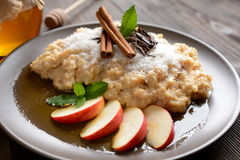 Sweet millet porridge with honey, apples and grated coconut stock photos
