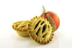 Sweet Mince Pies and Red Bauble Royalty Free Stock Image