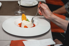Sweet mini dessert with strawberry on a plate in the expensive restaurant. close view Stock Photography
