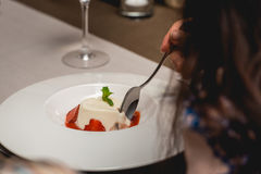 Sweet mini dessert with strawberry on a plate in the expensive restaurant. close view Royalty Free Stock Image