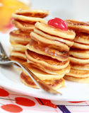 Sweet mini pancakes with pancake maker Royalty Free Stock Image