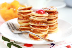 Sweet mini pancakes with pancake maker Stock Images