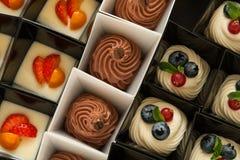 Sweet mini tarts in black and white box Stock Photos