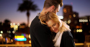 Sweet modern couple hugging outdoors at night Stock Photo